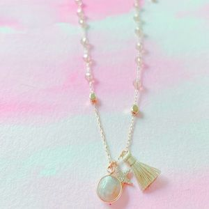 Gold, beads, tassel, and charms necklace